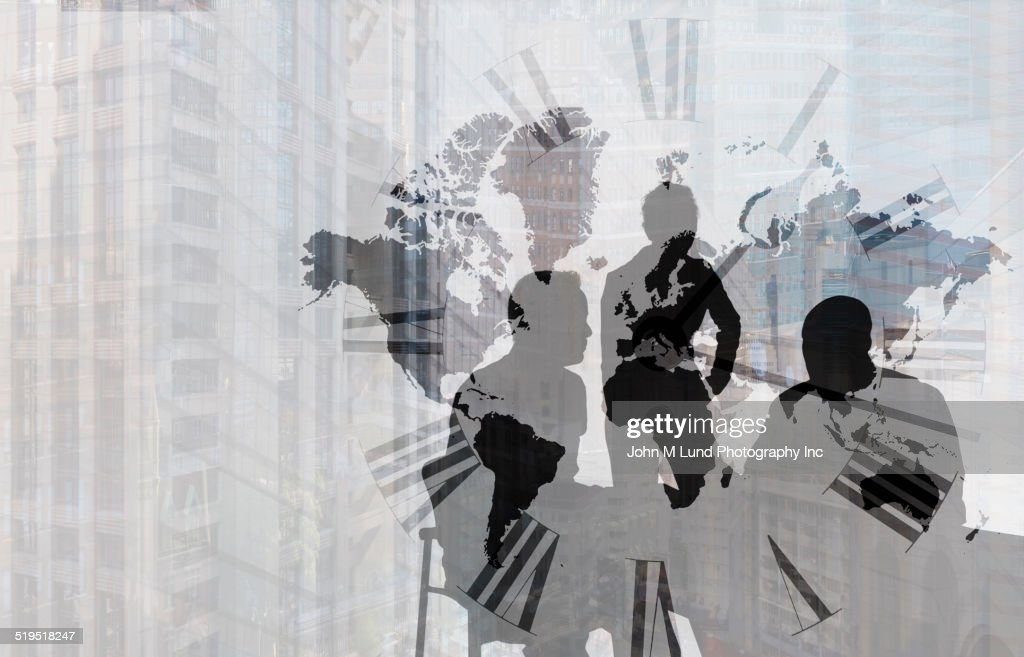Silhouette of Caucasian business people near clock face, world map and cityscape