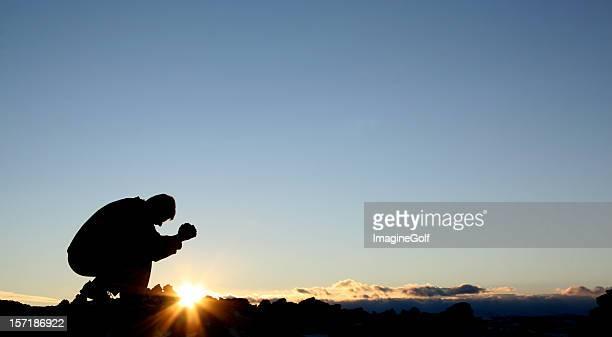 Silhouette of Caucasian Male Praying