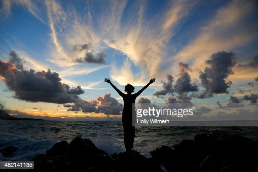 Silhouette of Caucasian woman on beach at sunset : Stock Photo