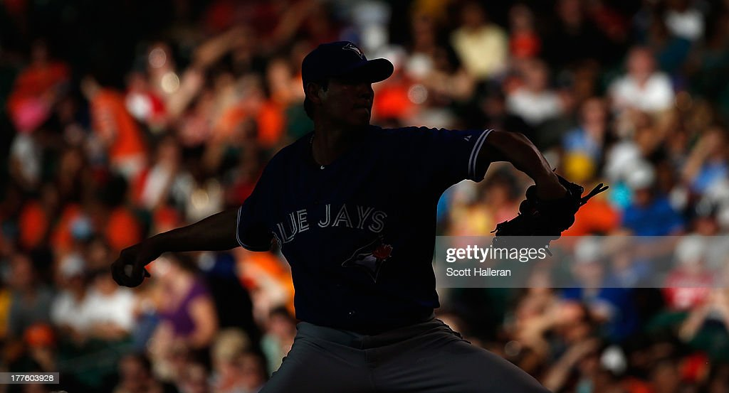 A silhouette of Chien-Ming Wang #67 of the Toronto Blue Jays throwing a pitch in the second inning against the Houston Astros at Minute Maid Park on August 24, 2013 in Houston, Texas.