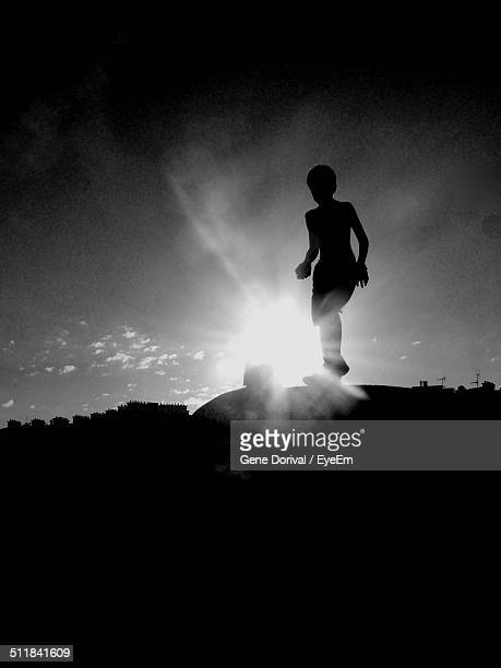 Silhouette of child playing