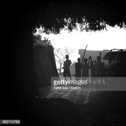 Silhouette Of Children In Rural Scenery