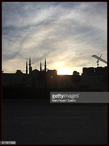 Silhouette of city at sunrise