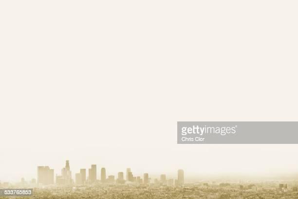 Silhouette of city skyline in hazy sky, Los Angeles, California, United States
