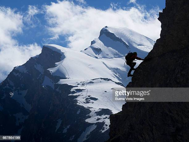 Silhouette of climber on a rocky wall