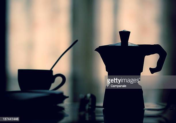Silhouette of coffee cup and pot