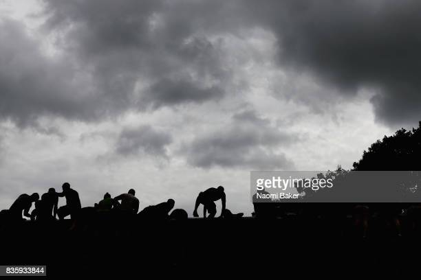 Silhouette of competitors during the 2017 Tough Mudder South West at Badminton Estate on August 20 2017 in Cirencester England