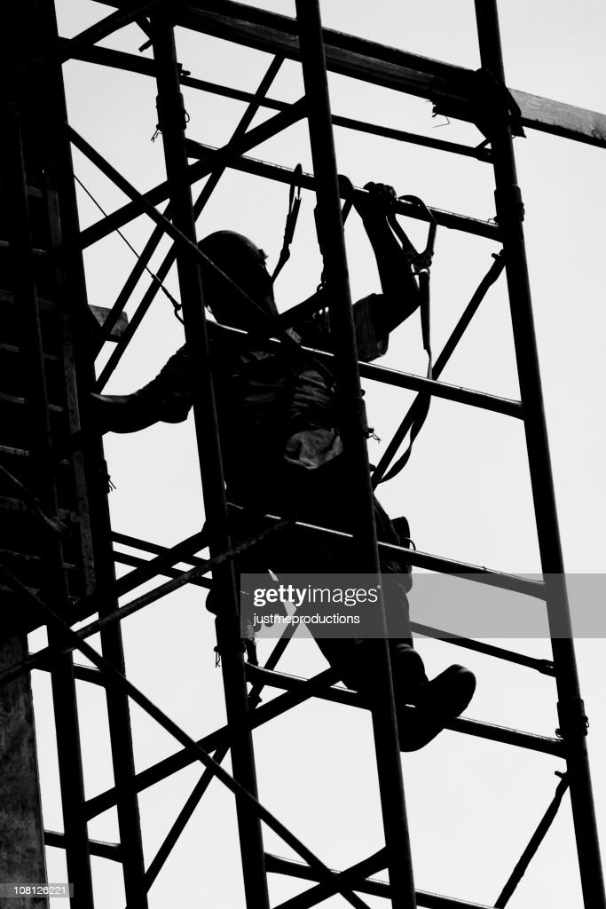 Silhouette of Construction Worker on Scaffolding : Stock Photo