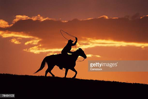 Silhouette of cowboy on horseback near Fairplay, Colorado