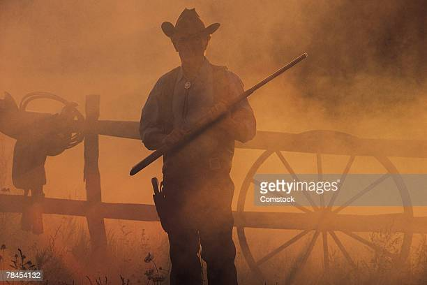 Silhouette of cowboy with rifle in hand
