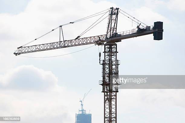 Silhouette of crane in blue sky