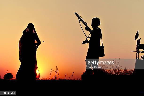 Silhouette of dancer and musician