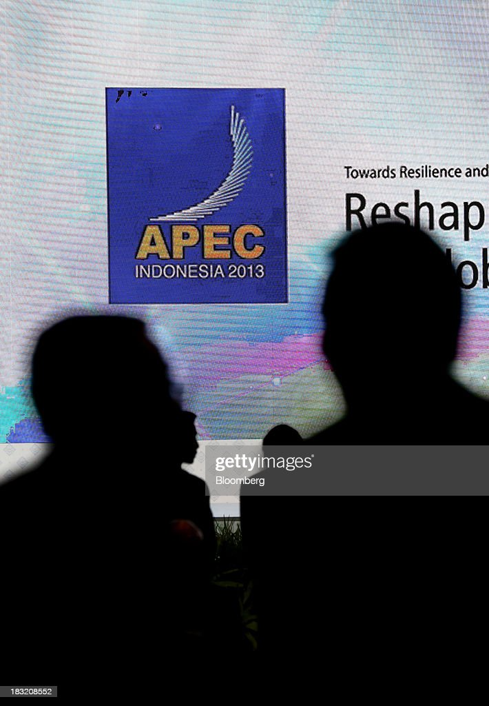 Silhouette of delegates are seen at the Asia-Pacific Economic Cooperation (APEC) CEO Summit in Nusa Dua, Bali, Indonesia, on Sunday, Oct. 6, 2013. Global growth will probably be slower and less balanced than desired, ministers from the APEC member economies said as they agreed to refrain from raising new barriers to trade and investment. Photographer: SeongJoon Cho/Bloomberg via Getty Images