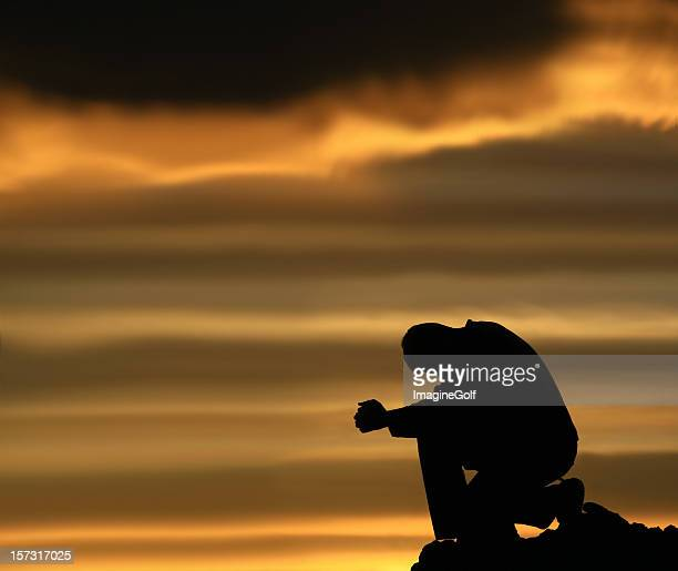 Silhouette of Depressed Man Contemplating Life