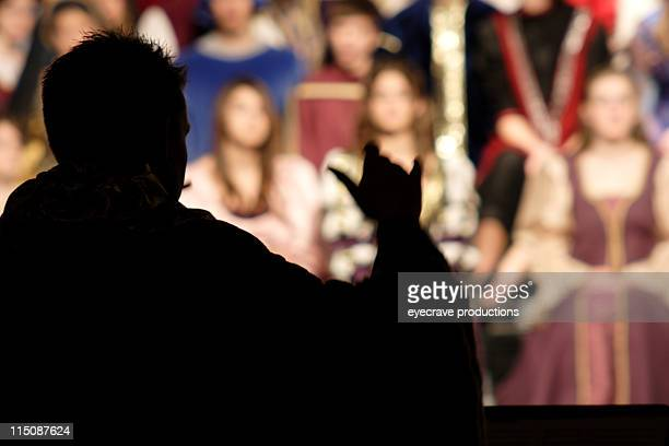 Silhouette of director of a Renaissance choir