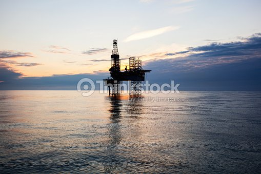 Silhouette Of Drilling Rig On The North Sea Stock Photo