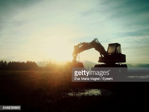 Silhouette Of Earth Mover At Sunset