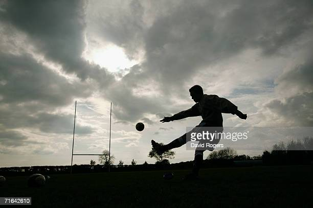 A silhouette of England and Newcastle Falcons Fly Half Jonny Wilkinson as he practises his kicking at Kingston Park during a feature on May 13 2004...