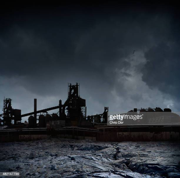 Silhouette of factories against stormy sky, Detroit, Michigan, United States