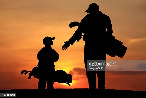 Silhouette of Father and Son on the Golf Course