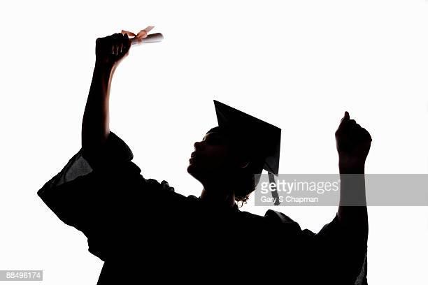 silhouette of female graduate