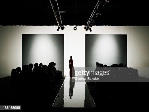Silhouette of female model on catwalk