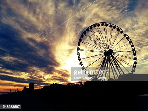 Silhouette Of Ferris Wheel At Sunset Stock Photo | Getty ...