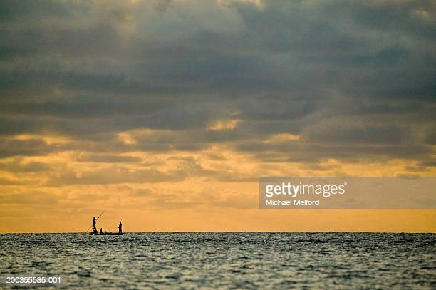 Silhouette of fishermen on saltwater flats, morning