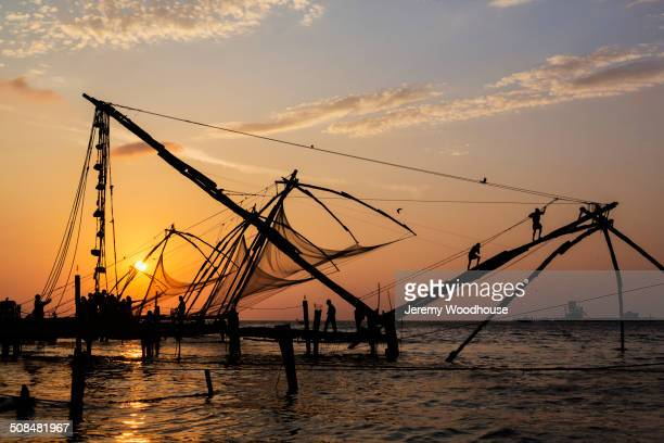 Silhouette of fishing nets at sunset