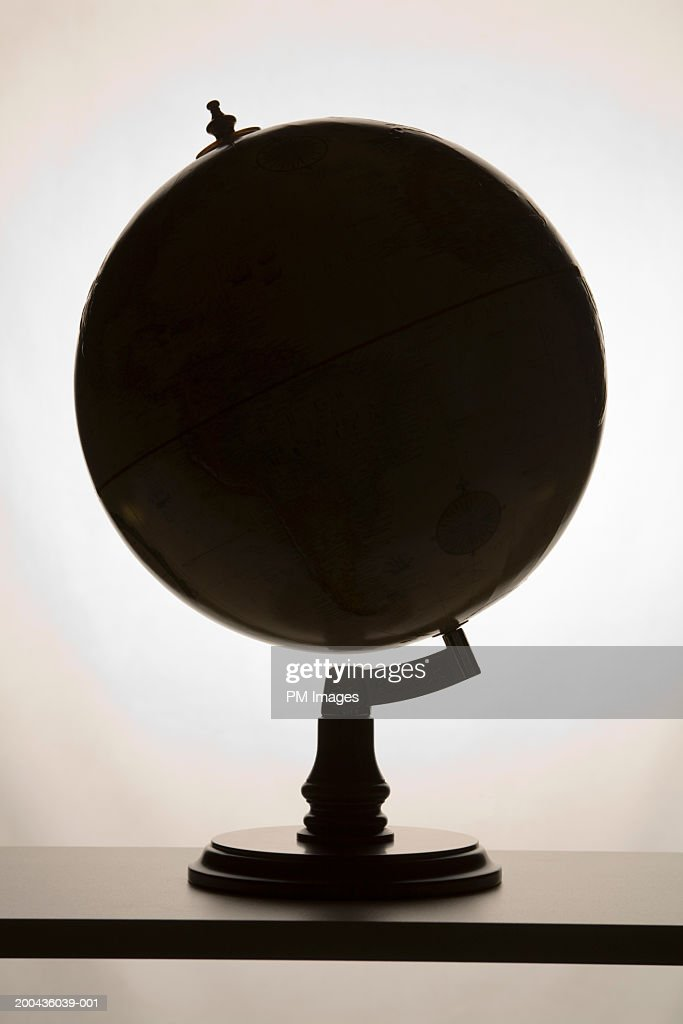 Silhouette of globe : Stock Photo