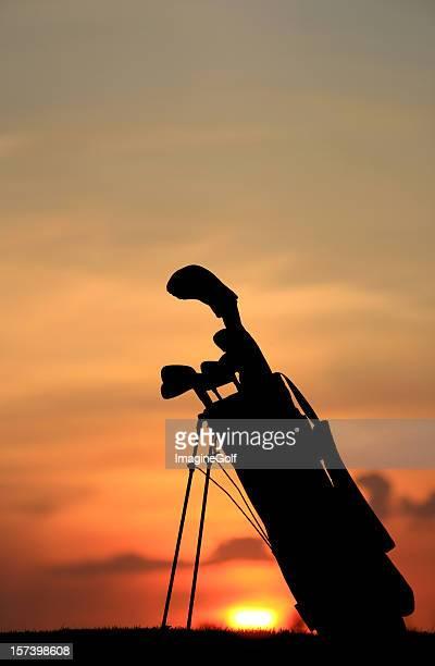 Silhouette of Golf Bag Against Sunset
