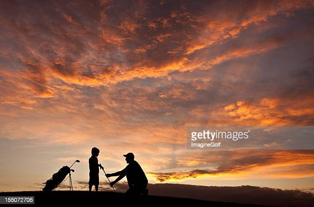 Silhouette of Golf Instructor Teaching a Child