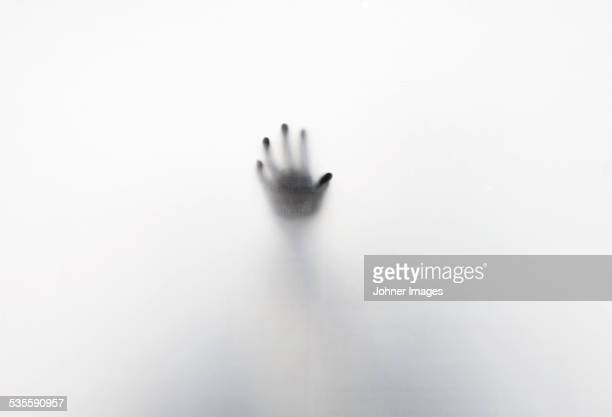 Silhouette of hand on white background