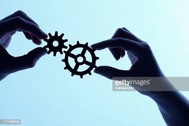 Silhouette di mani holding rotelline e sfoggiare