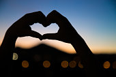 Silhouette of hands making a heart shape