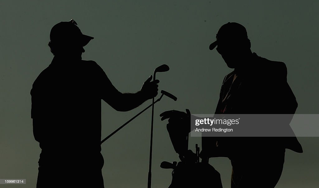 A silhouette of <a gi-track='captionPersonalityLinkClicked' href=/galleries/search?phrase=Justin+Rose&family=editorial&specificpeople=171559 ng-click='$event.stopPropagation()'>Justin Rose</a> of England and his caddie Mark Fulcher during the second round of the Commercial Bank Qatar Masters held at Doha Golf Club on January 24, 2013 in Doha, Qatar.