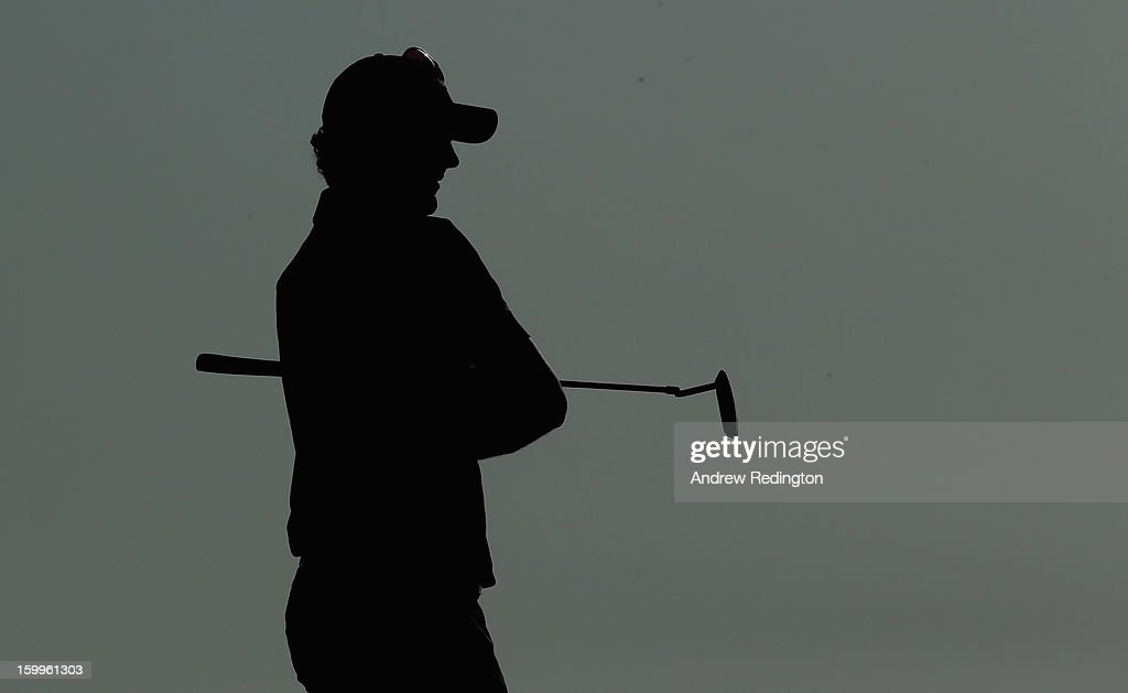 A silhouette of <a gi-track='captionPersonalityLinkClicked' href=/galleries/search?phrase=Justin+Rose&family=editorial&specificpeople=171559 ng-click='$event.stopPropagation()'>Justin Rose</a> of England during the second round of the Commercial Bank Qatar Masters held at Doha Golf Club on January 24, 2013 in Doha, Qatar.
