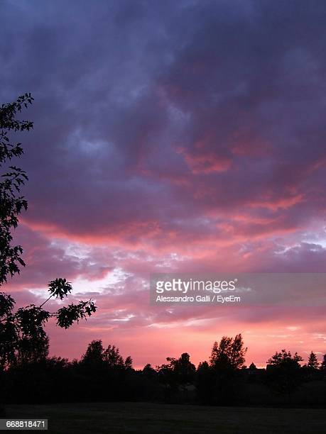 Silhouette Of Landscape Against Cloudy Sky