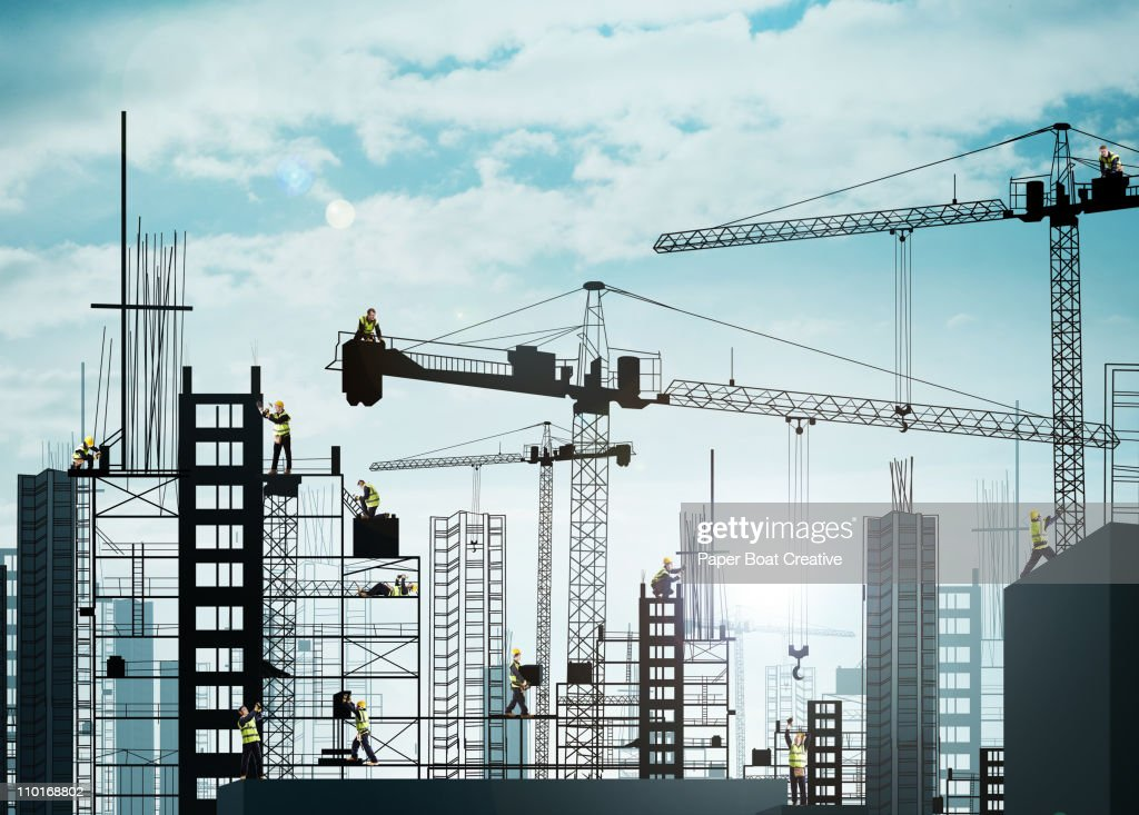 Silhouette of large building site with builders
