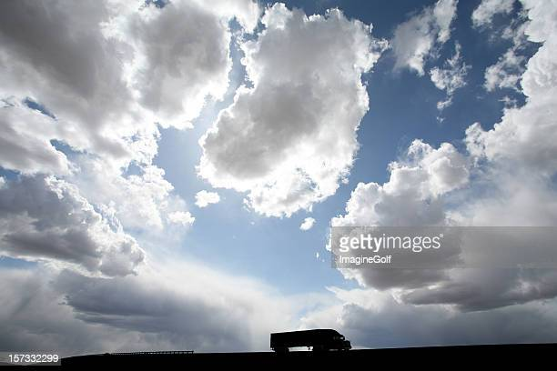 Silhouette of Long Distance Trucking or 18-Wheeler