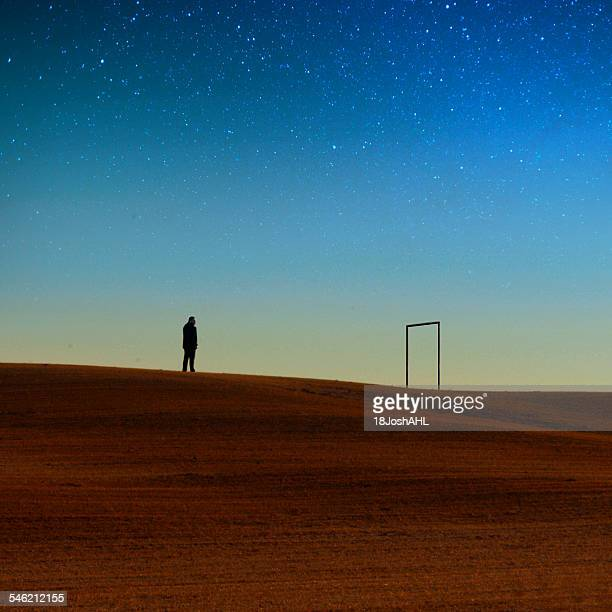 Silhouette of man against night sky