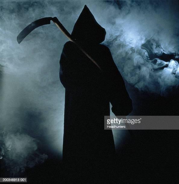 Silhouette of man dressed as 'Grim Reaper'