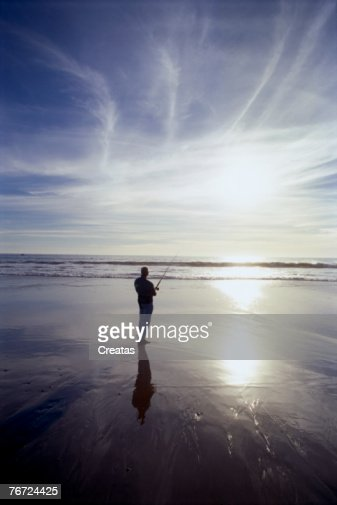 Silhouette of man fishing : Stock Photo