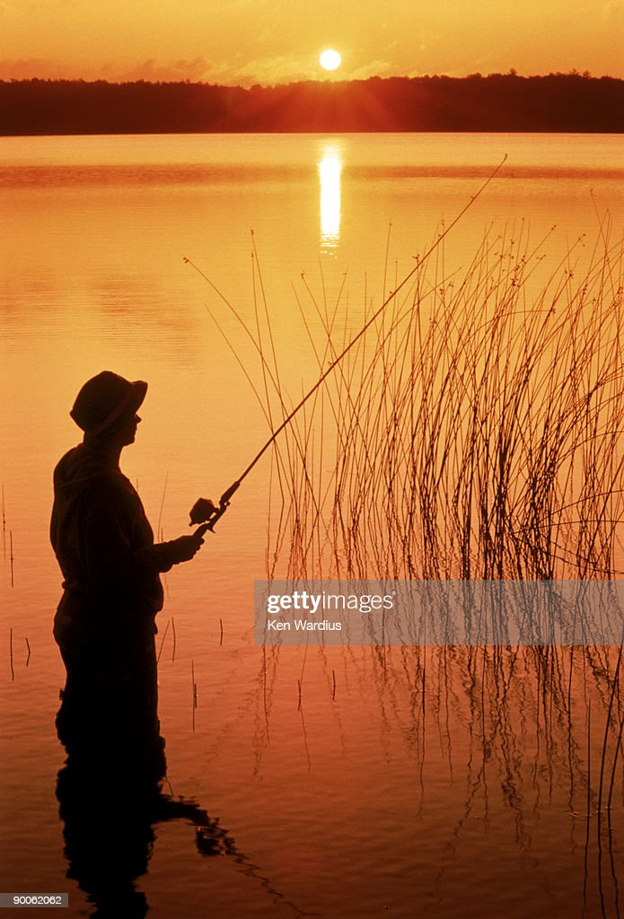 Silhouette of man fishing vilas city wisconsin stock photo for Wisconsin fishing license cost