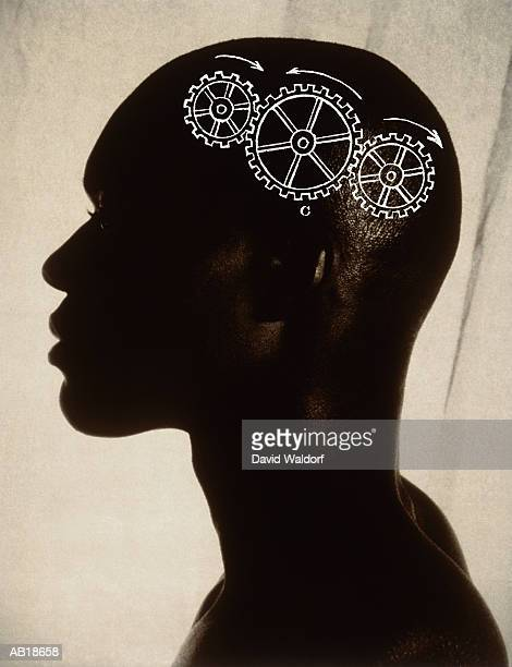 Silhouette of man, gears superimposed over brain (Composite)