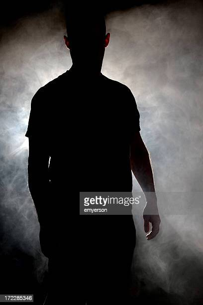 Silhouette of man in a cloud of smoke