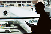 Silhouette of man in airport