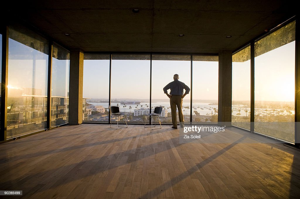 silhouette of man in empty condo, sunset : Stock Photo