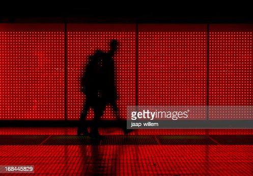 Silhouette of man moving in red background