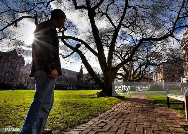 Silhouette of Man on a Brick Path